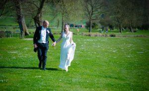 couple walking in wedding venue westbury